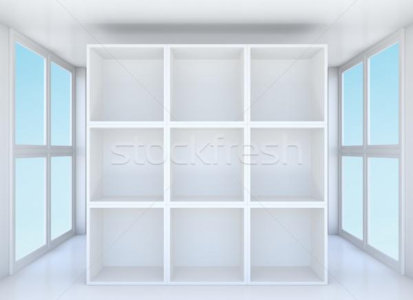 Empty showcase or bookshelf in clean room Stock photo © cherezoff