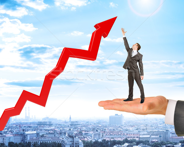 Man holds businessman with growth chart Stock photo © cherezoff