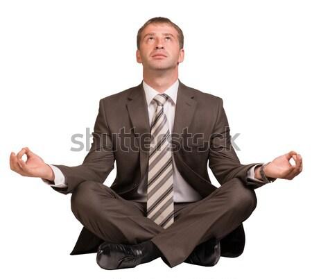 üzletember ül lótusz pozició izolált fehér Stock fotó © cherezoff