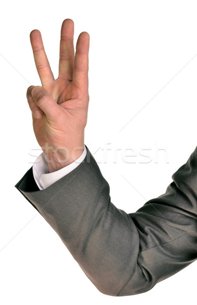 Businessman in suit shows three fingers Stock photo © cherezoff