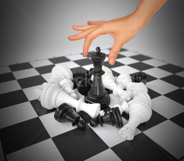 Mujer mano tocar rey figura tablero de ajedrez Foto stock © cherezoff