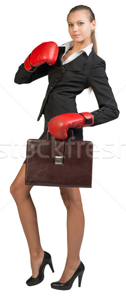 Businesswoman wearing boxing gloves holding briefcase Stock photo © cherezoff