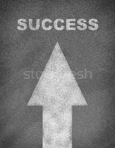 Asphalt road texture with arrow and word success Stock photo © cherezoff