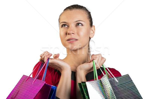 Sad lady handing bags narrowing her eyes Stock photo © cherezoff