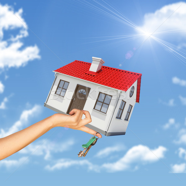 House and keys in womans hand Stock photo © cherezoff