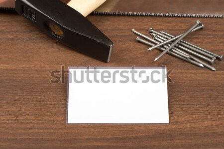 Hammer with badge and nails on table Stock photo © cherezoff