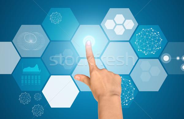 Humans arm touching virtual screen Stock photo © cherezoff