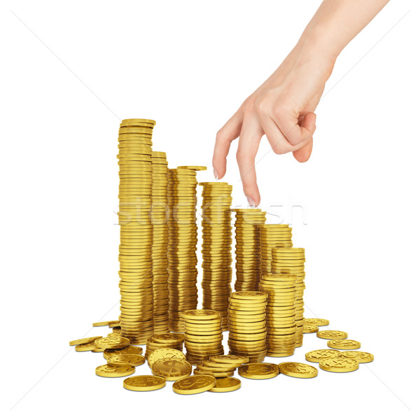 Womans hand with gold coins on white Stock photo © cherezoff