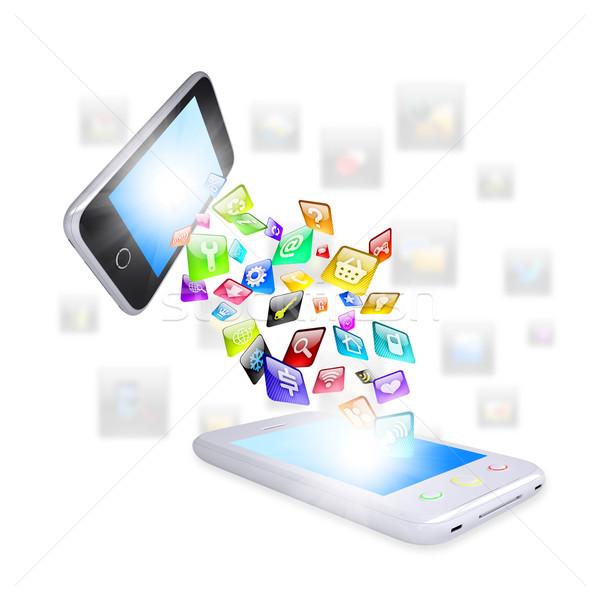 Two smartphone share content Stock photo © cherezoff