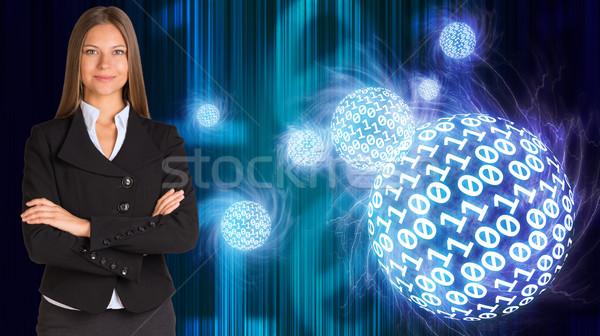 üzletasszony öltöny gömbök izzó számjegyek absztrakt Stock fotó © cherezoff