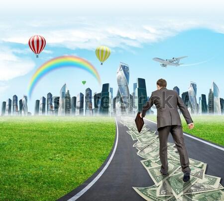 бизнесмен дороги вид сзади травой поле небе Сток-фото © cherezoff