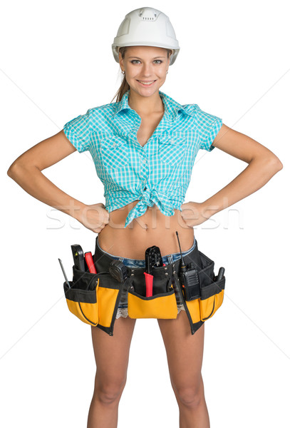 Pretty girl in helmet, shorts, shirt and tool belt with tools Stock photo © cherezoff
