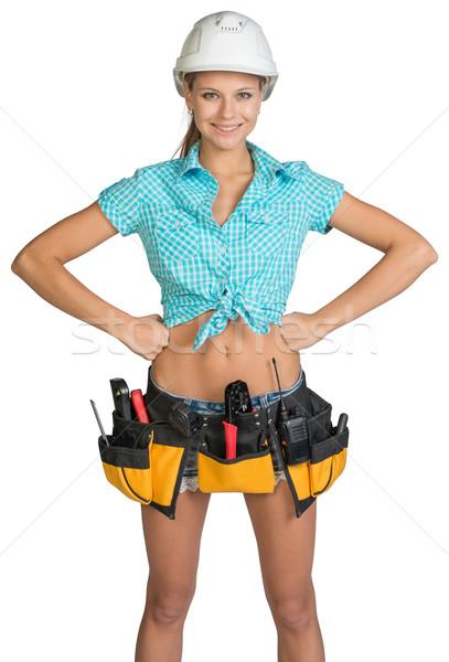 Сток-фото: довольно · девушки · шлема · шорты · рубашку · инструментом