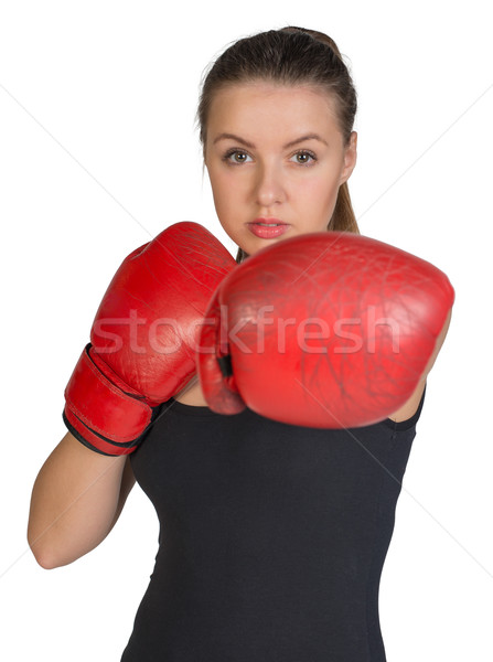 Woman in boxing gloves. Punching pose Stock photo © cherezoff