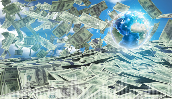 American money falling. Against background of globe earth and blue sky with clouds Stock photo © cherezoff