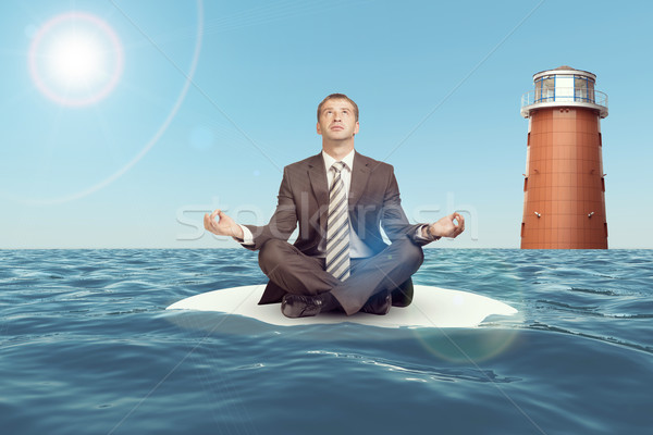 Businessman sitting in lotus position on sand  Stock photo © cherezoff