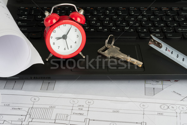 Laptop with drafts and key Stock photo © cherezoff
