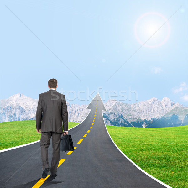 Man walking on highway road going up as an arrow Stock photo © cherezoff