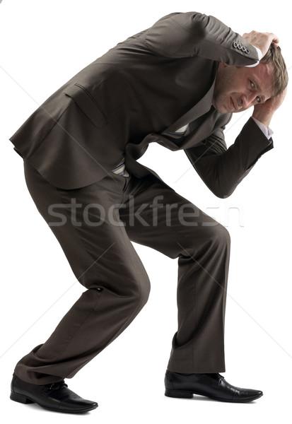 Csalódott üzletember tart fej portré fiatalember Stock fotó © cherezoff