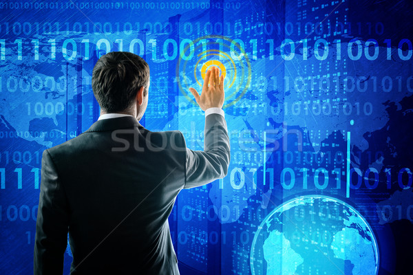 Businessman in suit pressing social media icon Stock photo © cherezoff
