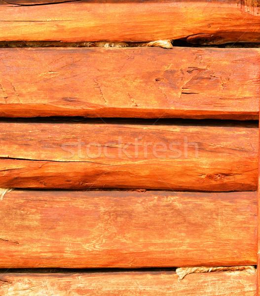 Wall made of wooden beams Stock photo © cherezoff