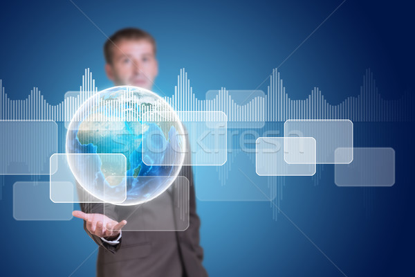 Businessman hold Earth with transparent rectangles and graphs Stock photo © cherezoff