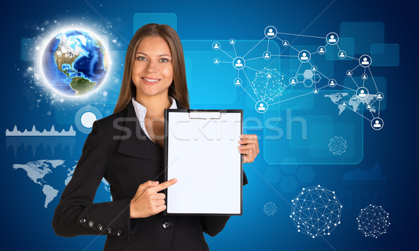 Beautiful businesswoman in suit holding paper holder Stock photo © cherezoff