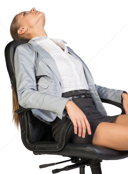 Businesswoman resting in office chair with her head thrown back  Stock photo © cherezoff
