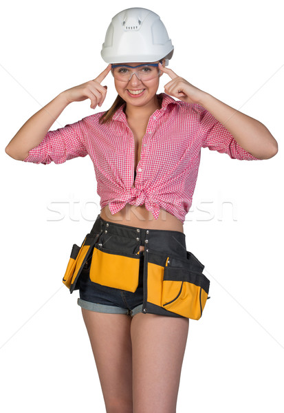 Woman in hard hat, protective glasses and tool belt Stock photo © cherezoff