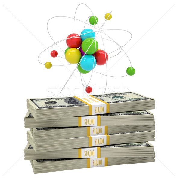 Atom structure on stack of money Stock photo © cherezoff