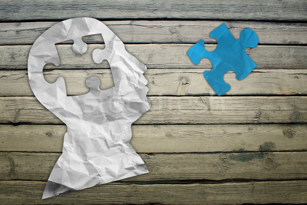 Paper humans head with blue puzzle symbol Stock photo © cherezoff