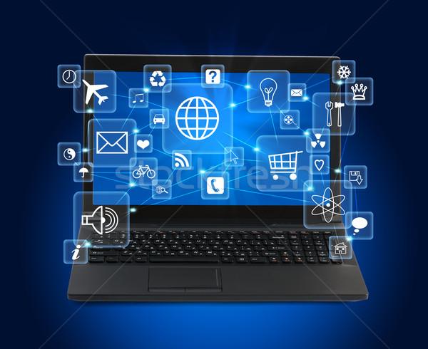 Black laptop with icons on blue Stock photo © cherezoff