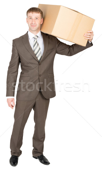 Delivery man carrying box over shoulder Stock photo © cherezoff