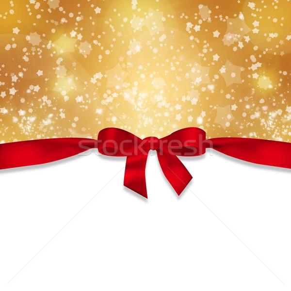 Red ribbon and snowflakes Stock photo © cherezoff