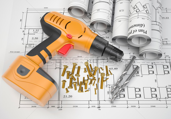Electric screwdriver, fastening hardware, borers, scrolled drafts, architectural drawing Stock photo © cherezoff