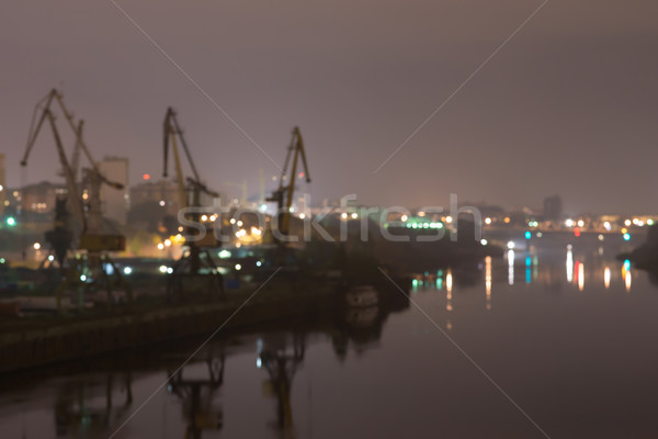 Industrial area with river port. Behind the houses, in front of water. Defocused image Stock photo © cherezoff