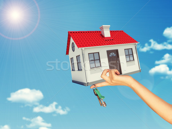 House and keys in womans left hand Stock photo © cherezoff
