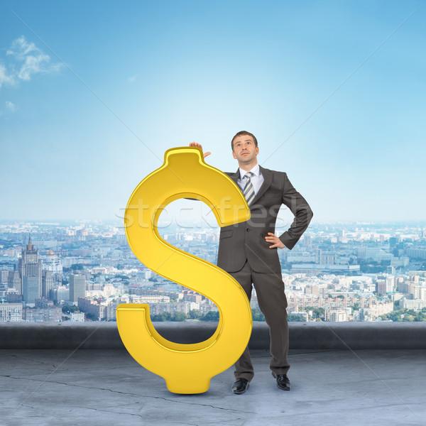 бизнесмен большой знак доллара Cityscape служба Сток-фото © cherezoff