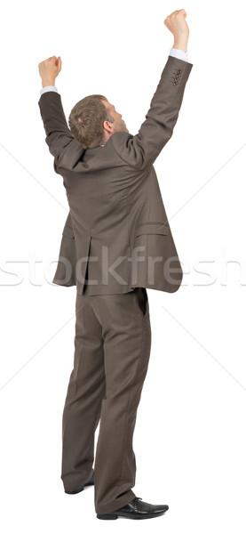 Businessman in winner posture on white Stock photo © cherezoff