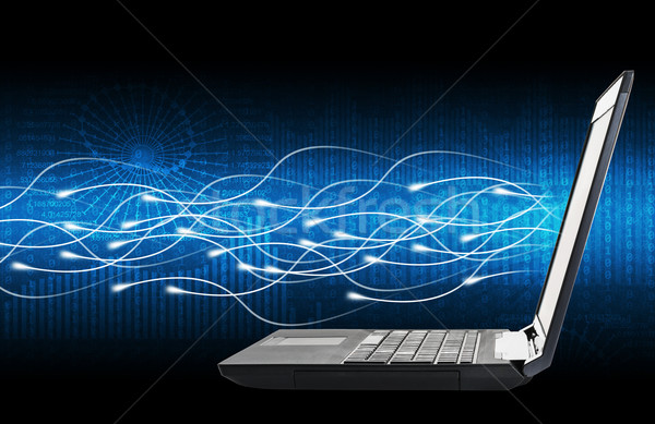 Laptop with lightspot and numbers on blue Stock photo © cherezoff