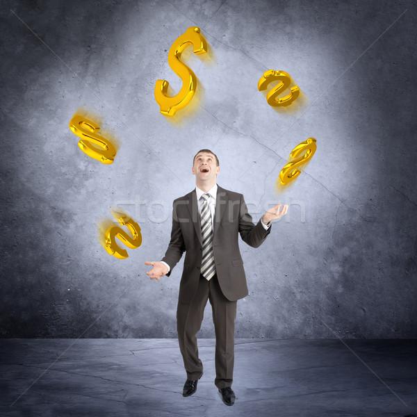 Zakenman jongleren dollarteken abstract grijs teken Stockfoto © cherezoff