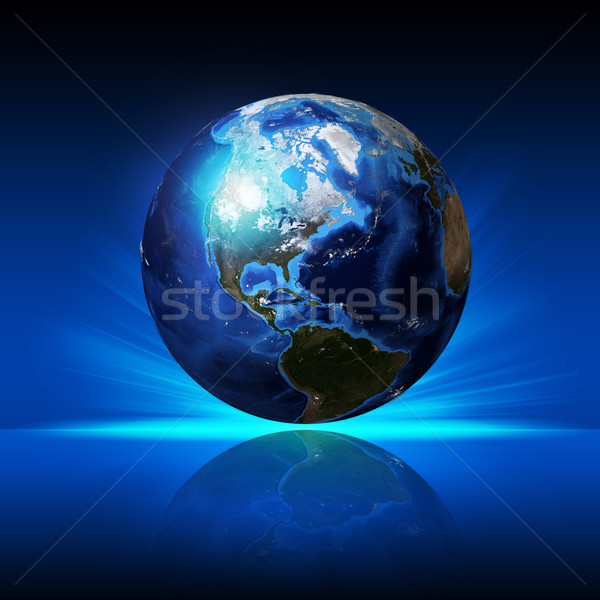 Earth planet on a reflective surface Stock photo © cherezoff