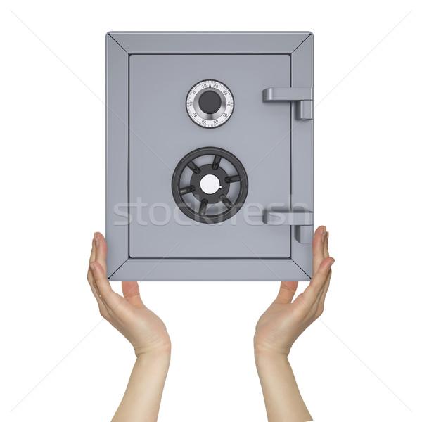 Hands holding safe Stock photo © cherezoff