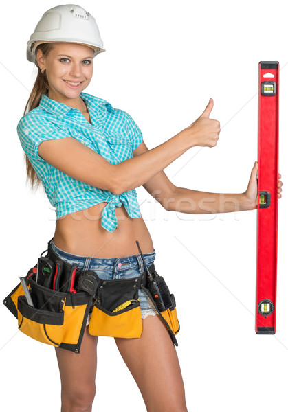 Belle fille blanche casque constructeurs niveau Photo stock © cherezoff