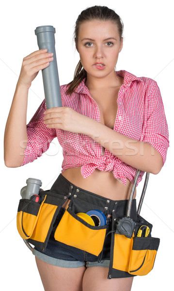 Woman in tool belt holding fitting pipe Stock photo © cherezoff