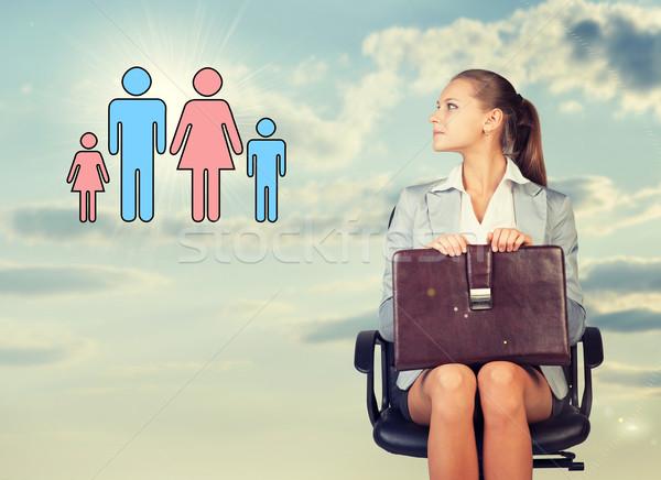 Iş kadını etek bluz ceket oturma sandalye Stok fotoğraf © cherezoff