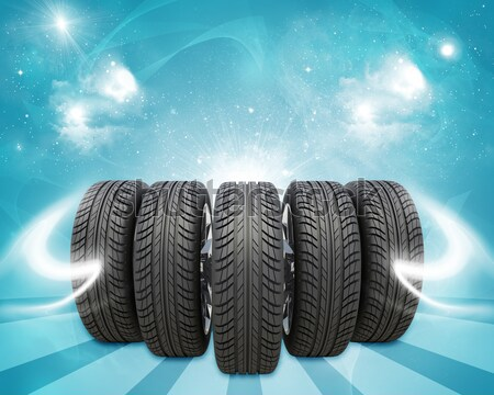 Wedge of new car wheels. Background is sky with clouds and stripes Stock photo © cherezoff