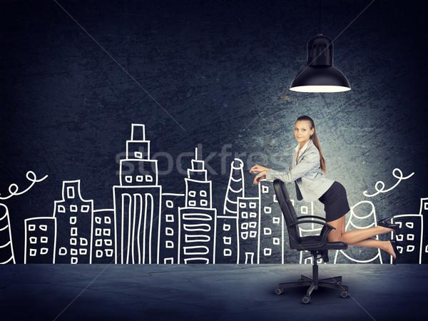 Businesswoman on Chair by Drawn City Skyline Stock photo © cherezoff