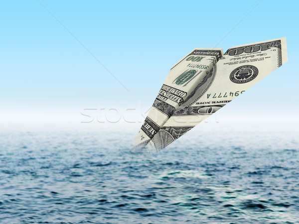 Bankruptcy business. Money plane crash in sea Stock photo © cherezoff