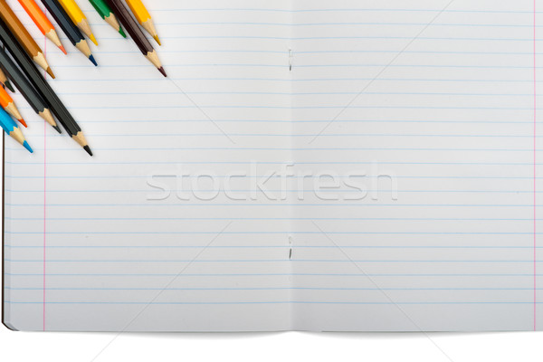 Open notebook with set of crayons Stock photo © cherezoff
